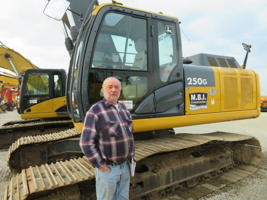 Kenneth Shoup of Shoup Rigging & Excavating likes what he sees in a John Deere 250G excavator.