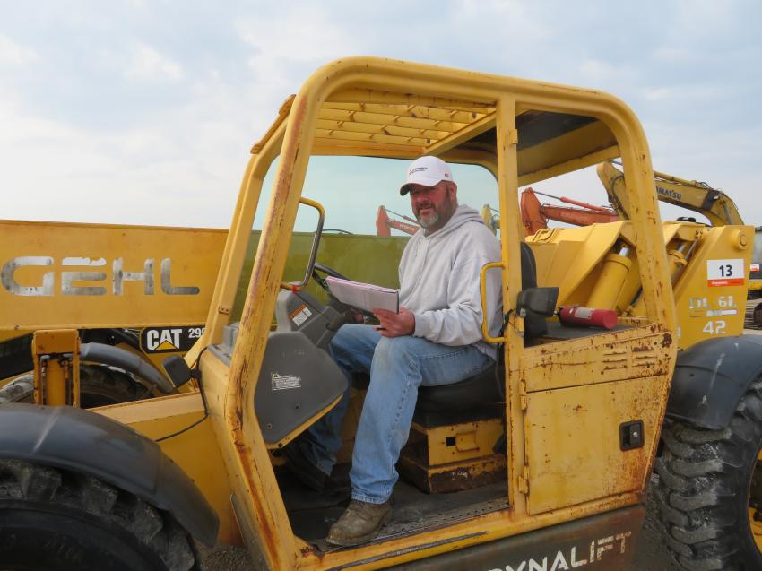 Mike Loecke, owner of Old 20 Auctions, runs a Gehl DL-6L rough-terrain forklift.