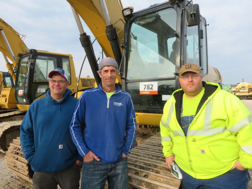 (L-R): Brian Kedas and Daniel Ribbe, both of Ribbe Trucking, and Nick O'Neil of Big O Services look over the excavators at the Morris, Ill., sale.