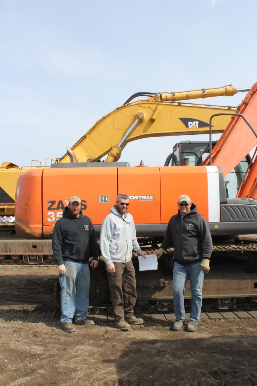 (L-R): Jeff Jahr, Digger Enterprises, Pemberton, Minn.; Taylor Forsberg, Forsberg Drainage and Excavating, Dunnell, Minn.; and Pete Eustice, Digger equipment operator, look for anything that is priced right.