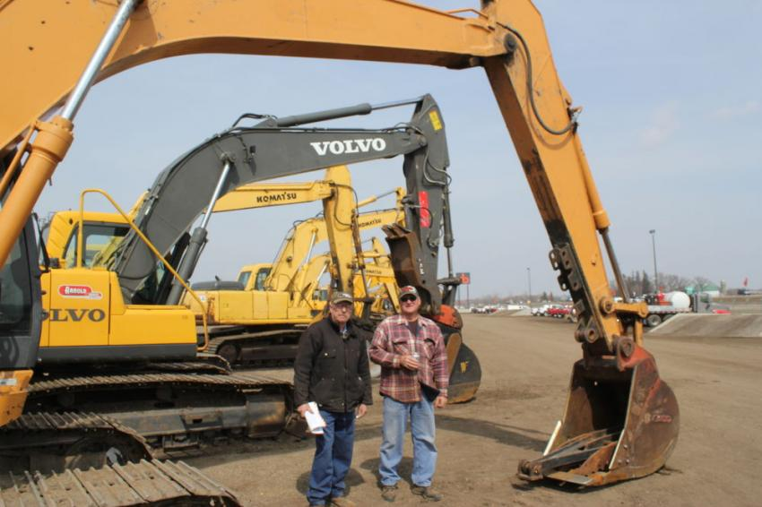 (L-R): Henry Nechville (L), owner of Nechville Excavating Inc., Roberts, Wis., checks out a Case CX 160B with his good buddy, Nechville equipment operator Dale Vrieze.