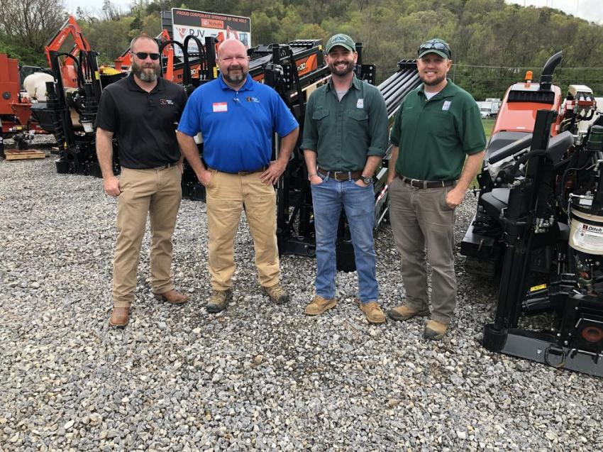 Going over the Ditch Witch JT20XP (L-R) are Mike Goodman and Kevin Schafluetzel of RJV Equipment and Nate Crisp and Blake Cooper of Athens, Tenn., Utility Board.