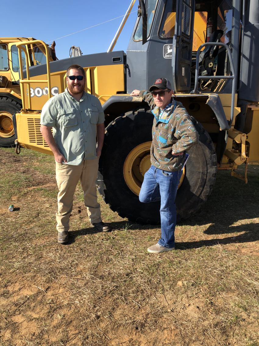 Looking over the artic trucks are Sam Maier (L) of Four D Equipment in Hazlehurst, Ga., and Josh Craycroft of Craycroft Equipment in Lexington, N.C.b