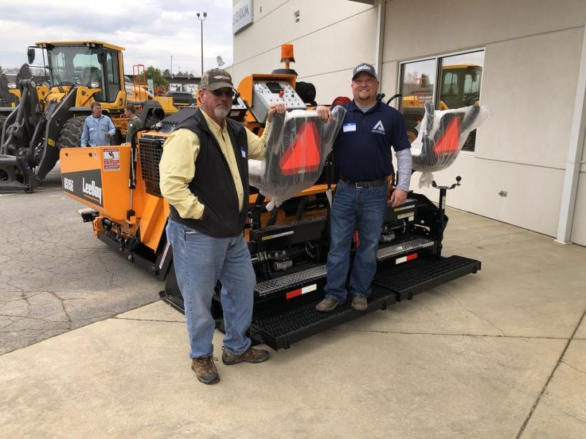 Alex Keith (L) of WNC Paving in Waynesville, N.C., talks shop with Scott Lee of Ascendum Machinery.