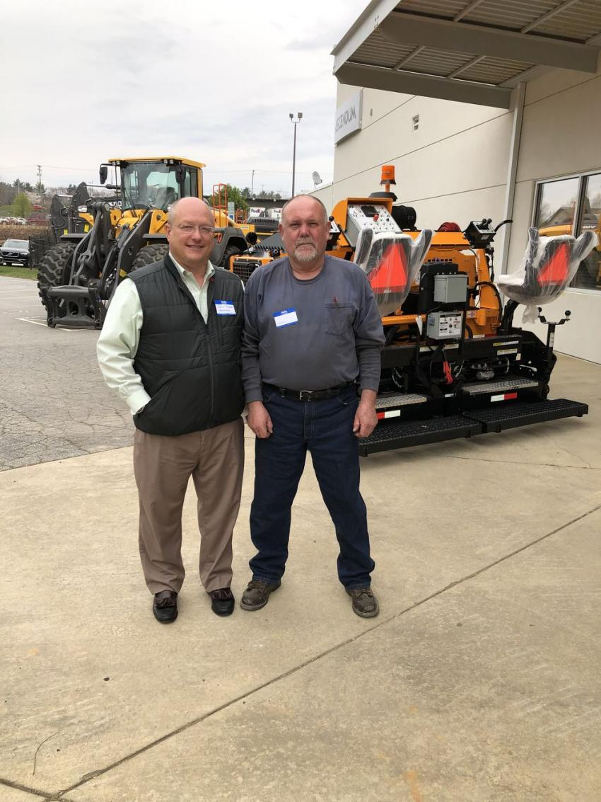 Kenny Bishop (L) of Ascendum Machinery welcomes Terry Orr of Tar Heel Paving in Hendersonville, N.C.