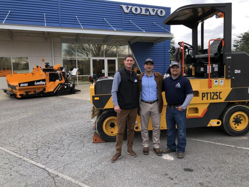 (L-R): Adam Wade, Mario Stoilovich and Scott Lee, all of Ascendum Machinery, stand in front of a Volvo PT125C nine-wheeled pneumatic tire roller, an adaptable machine that delivers uniform smoothness and long-lasting performance. Wade is Ascendum's new road machinery segment manager and paving specialist, and Lee is its new LeeBoy product specialist.