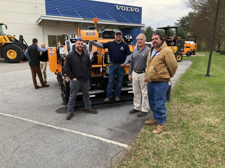 (L-R): Jordan Thacker, Scott Lee and Steve Brown of Ascendum Machinery talk with Jeff Hart of Carolina Paving, Mills River, N.C. about the 8520C asphalt paver. This machine features a higher-horsepower engine along with a larger hopper capacity guaranteed to deliver outstanding results. Using LeeBoy's efficient material management system, the wide, slow-moving conveyor moves material consistently from the truck to the screed, ensuring a flawless mat.