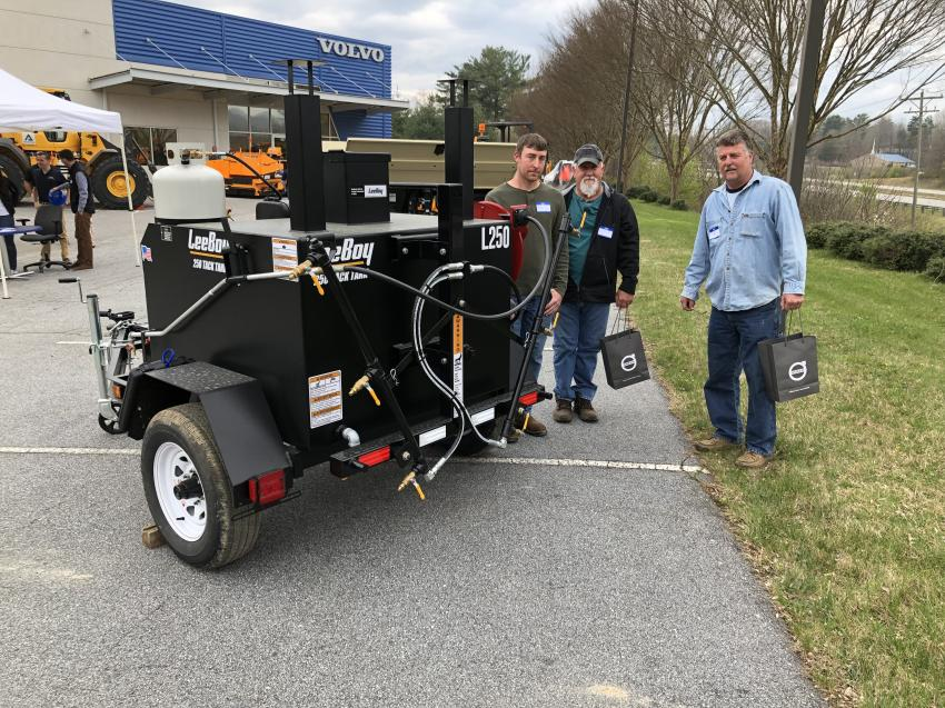 Looking over the LeeBoy 250 tack tank (L-R) are Brian Holcombe, Terry Coates and David DuPree, all of Lonesome Mountain Paving in Marshall, N.C.