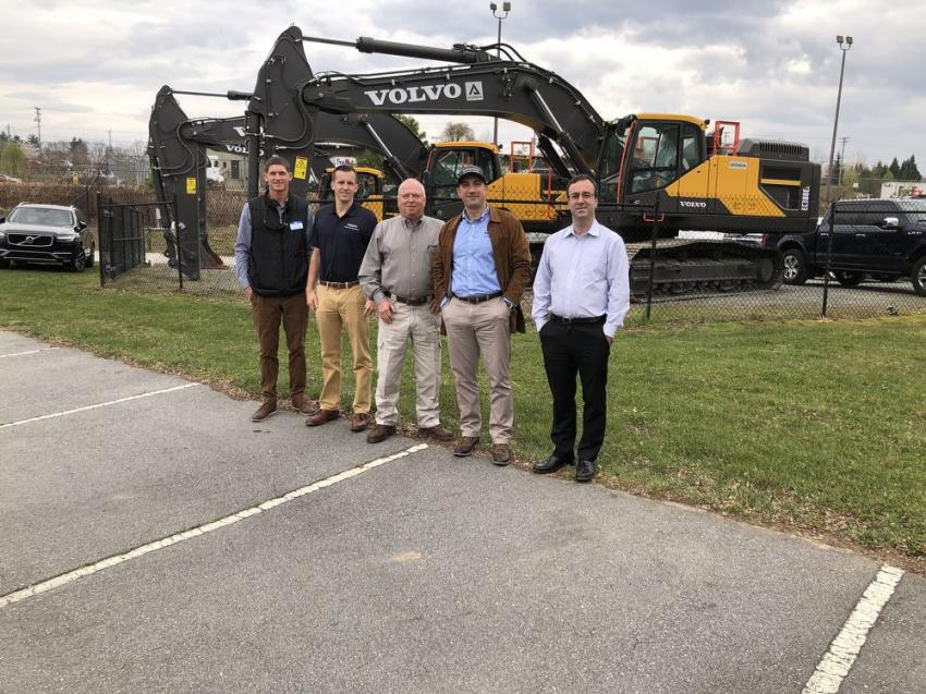 Getting together in front of a lineup of Volvo excavators (L-R) are Adam Wade, Ascendum Machinery; Kevin Scotese, Volvo; Gary Atkinson, Volvo; Mario Stoilovich, Ascendum Machinery; and Nuno Colaco, Ascendum Machinery.