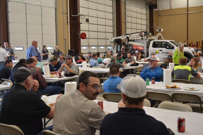 More than 150 customers and employees attended the grand opening celebration.