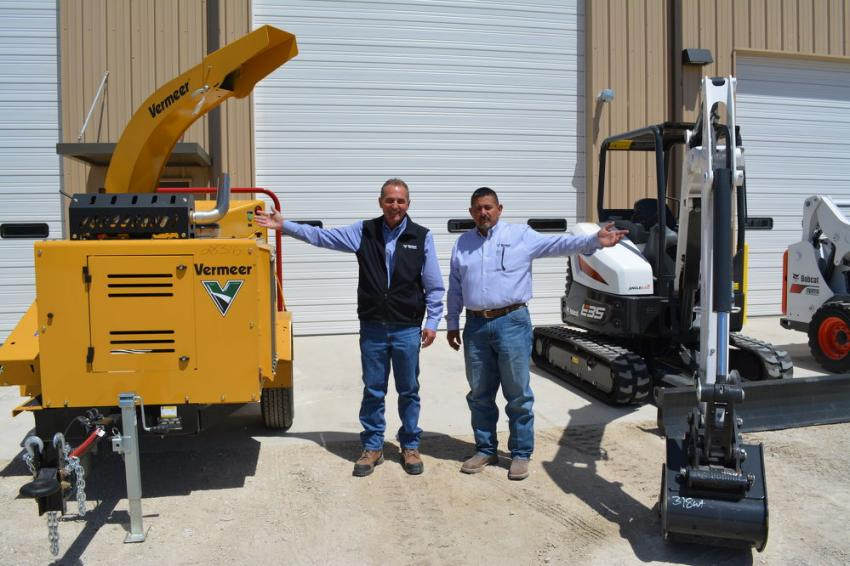 Customers choice: Mark Unzicker (L), Vermeer Texas-Louisiana sales manager and Dan Sandoval, Waco branch manager, show off the Vermeer BC100XL brush chipper and the Bobcat E35 excavator. The Waco branch is co-branded.