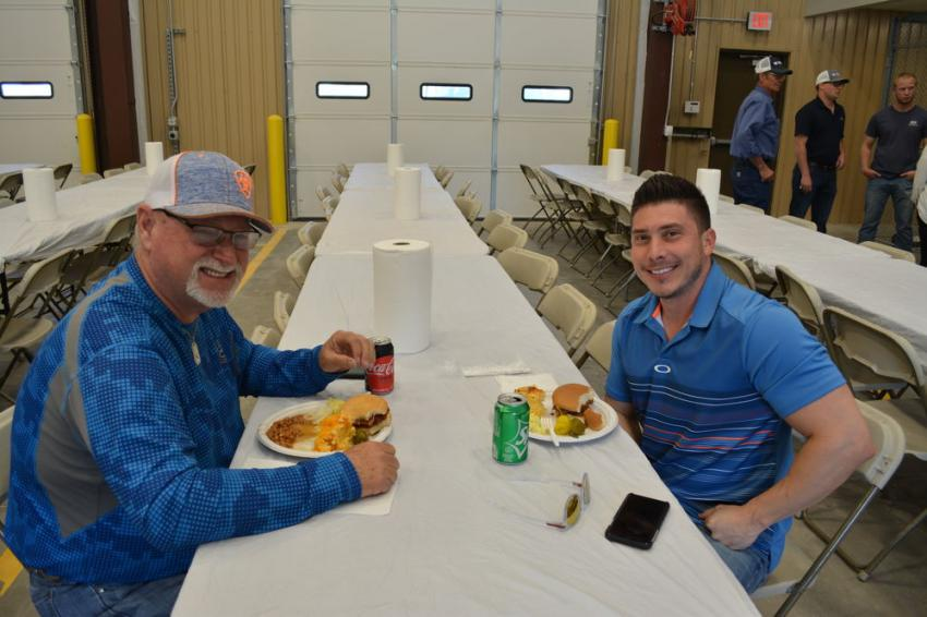 Don Hall (L) and Chad Boen of Boen Landscaping of Waco enjoy lunch at the Vermeer and Bobcat open house. Boen uses Vermeer mulchers in his landscape business.