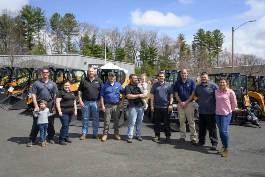 Monroe Tractor's South Windsor, Conn., team at the grand opening of their new location. (L-R): Charlie Patenaude, service manager and son, Mason; Nichole Gretta, product support; Mike Uricchio, parts specialist; Seth Cerone, sales manager; Jesse Miller, sales and daughter, Ava; Chris Donovan, technician; Craig Robbins, branch manager; Greg Schumaker, technician; and Laura Wilkas, assistant general manager.