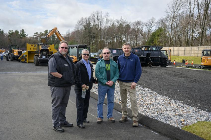 (L-R): Glenn Schmidt, parts and sales manager of CNH of Ballston Spa, N.Y.; Bob Nute, Case product support of Newtown, Conn.; Garry Jones of Northland JCB in Wilmington, Mass., and Dan Duhn, service manager of Monroe Tractor in Worcester, Mass., enjoy the grand opening event.