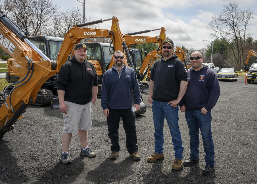 (L-R): Jay Rindflesh of Collinsville Towing and Transport in Canton, Conn.; Tim Wheeler of Wheeler Construction in Avon, Conn.; Chris Kulinski of the town of Barkhamsted, Barkhamsted, Conn.; and Corey Tucker of Torrington, Conn., check out the variety of machinery on Monroe Tractor's two-acre lot.