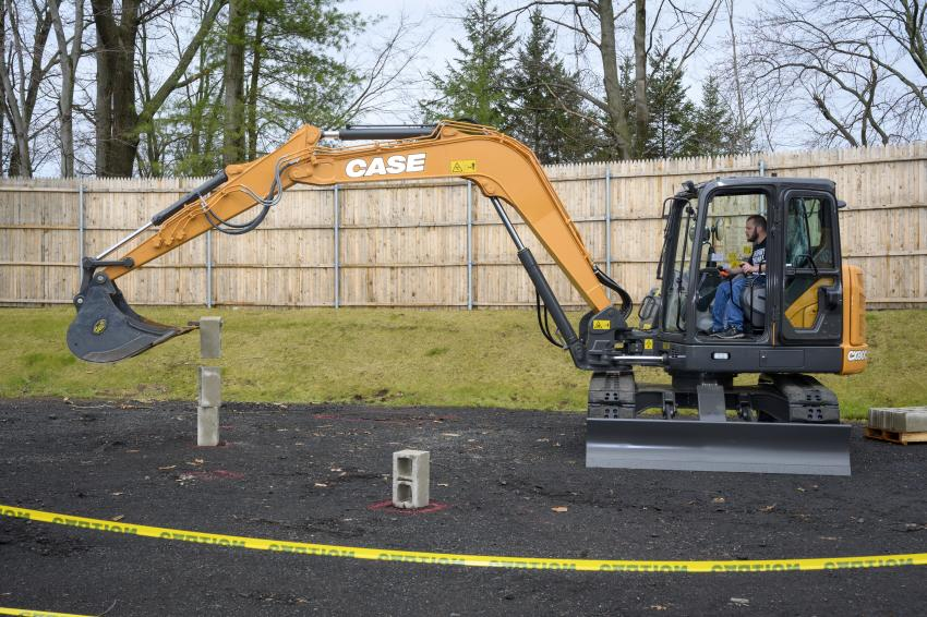 Zach Fairchild of D&Z Construction from Thomaston, Conn., competes on a Case CX80C Midi excavator stacking cinder blocks.