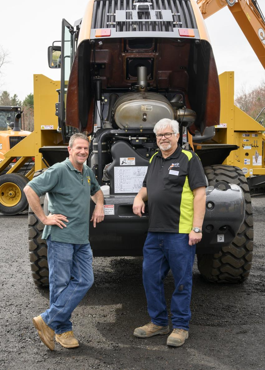 Richie Roulston (L) of Roulston Services LLC of Windsor Locks, Conn., and Chuck Miller, Monroe Tractor general manager, construction equipment division from New Berlin, N.Y., in front of a Case 721G wheel loader.
