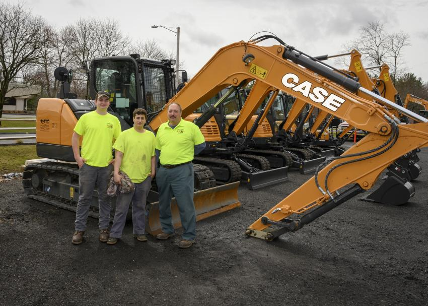 (L-R): Tyler, Bob III and Bob Giola, all of Giola Corp. Landscaping and General Construction in Manchester, Conn., check out a Case CX57C mini-excavator.