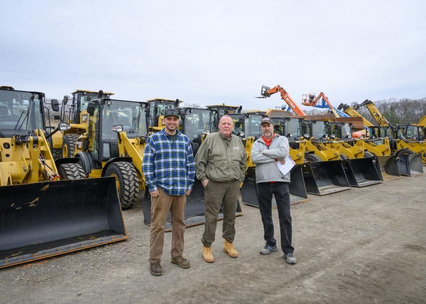 (L-R): Jake Weeks; Dave Mailhot of Mailhot Enterprises, Concord, N.H.; and Mike Flynn of Flynn Drive and Sealant in Massena, N.Y., check out the options of rubber-tired loaders.