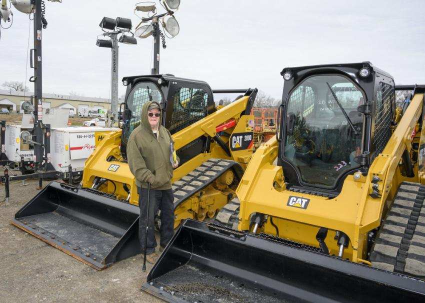 Mark Devlin of J. Mark Inc. in Hanson, Mass., in front of 2018 and 2019 Caterpillar 289DXPS compact track loaders.