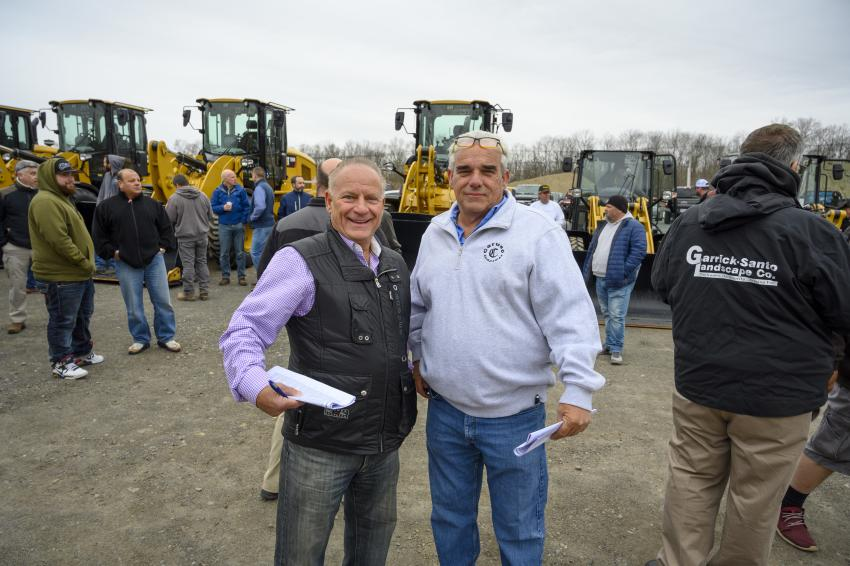 Ralph Curuso (L) and David Kane, both of Caruso Companies in Revere, Mass., wait to place a bid.