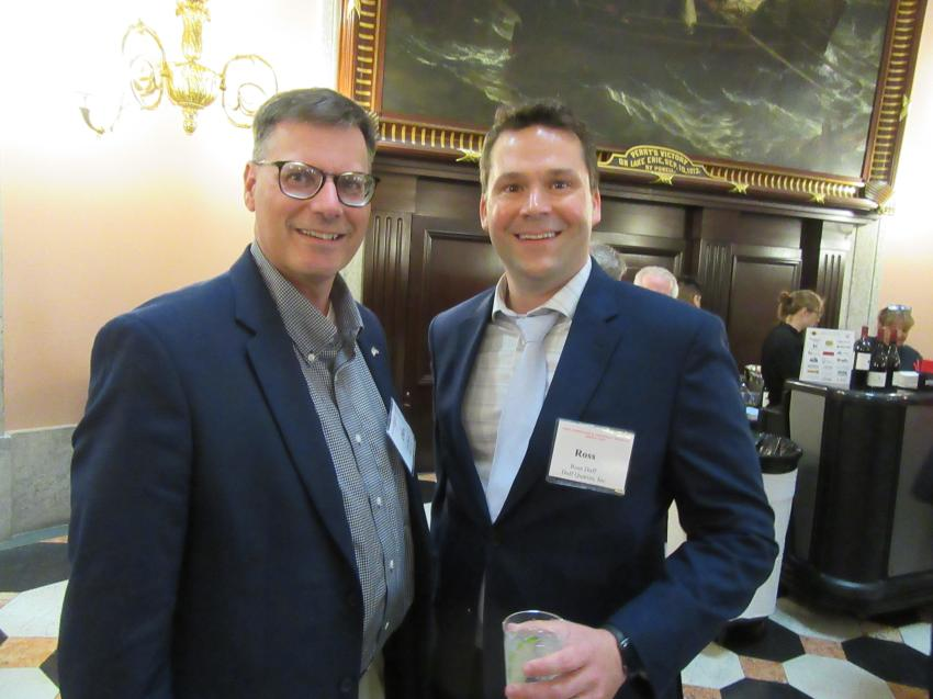 Ohio Cat's Chris Harris (L) talks aggregates equipment with Ross Duff of Duff Quarries at the legislative reception.