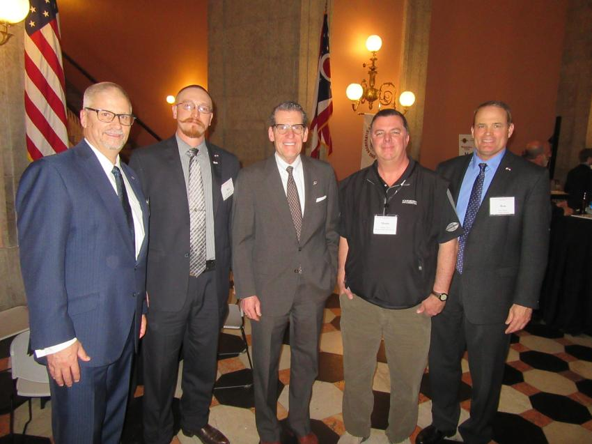 (L-R): OAIMA Executive Director Pat Jacomet, Ben Kotkowski of Lakeside Sand & Gravel; state Sen. John Eklund; Monte Yates of Barrett Paving Materials Inc.; and Ron Tipton of Lehigh Hanson talk aggregates issues at the reception.