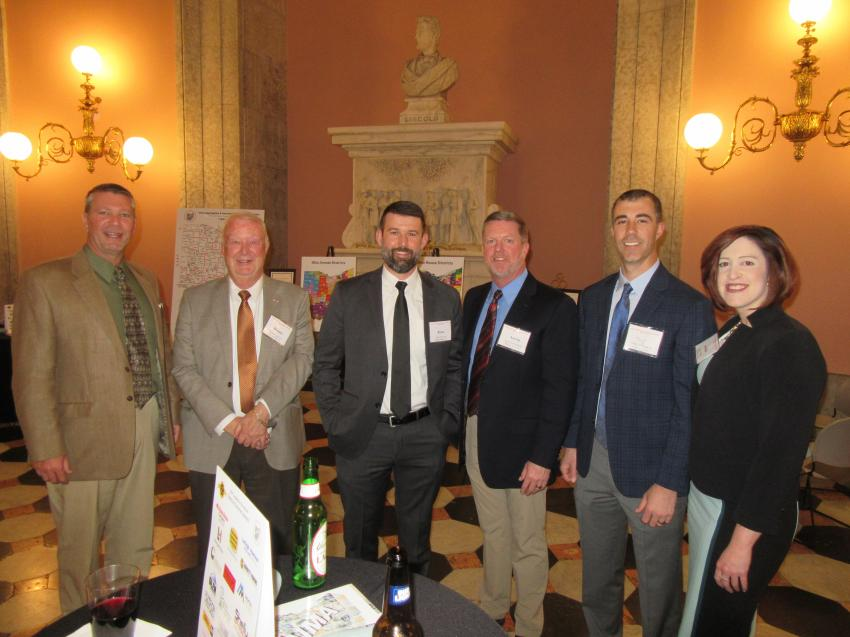 (L-R): Todd Young of Mar-Zane Materials Inc.; Dennis and Ryan Garrison and Aaron Mollenkamp of Melvin Stone Company; Troy Stegner of Shelly Company; and Jackie Walker of SkillsUSA Ohio catch up at the reception.