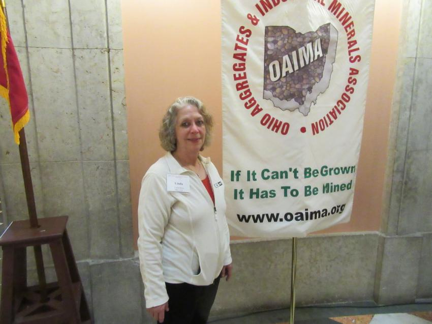 Ohio Cat's Linda Meier, who is actively involved with OAIMA, helped welcome attendees to the legislative reception.