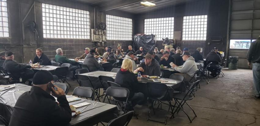 Guests enjoy a complimentary lunch at Farm-Rite Equipment's open house in Willmar, Minn.