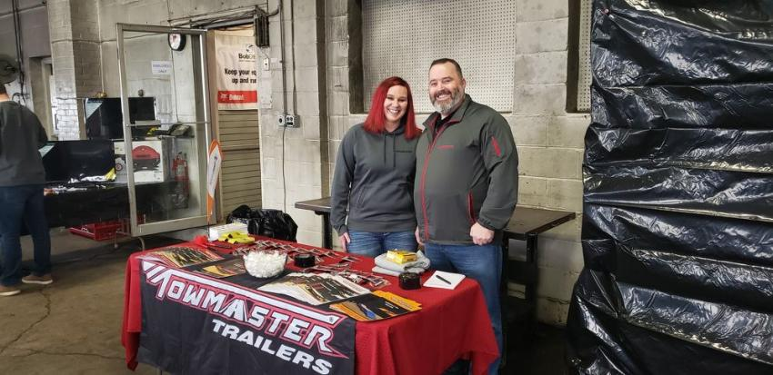Jen Boreen and Bob Pace represent Towmaster at the open house.