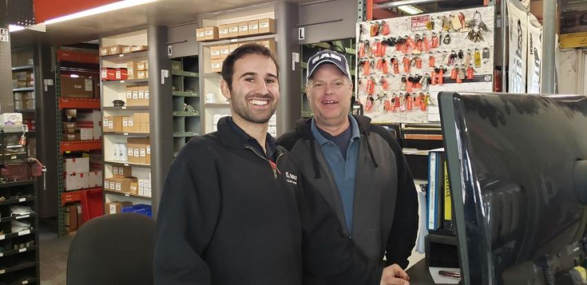 Farm-Rite parts manager Dan Cox (L) greets Larry Rick of Thumbs Up Handyman LLC,  Litchfield, Minn.