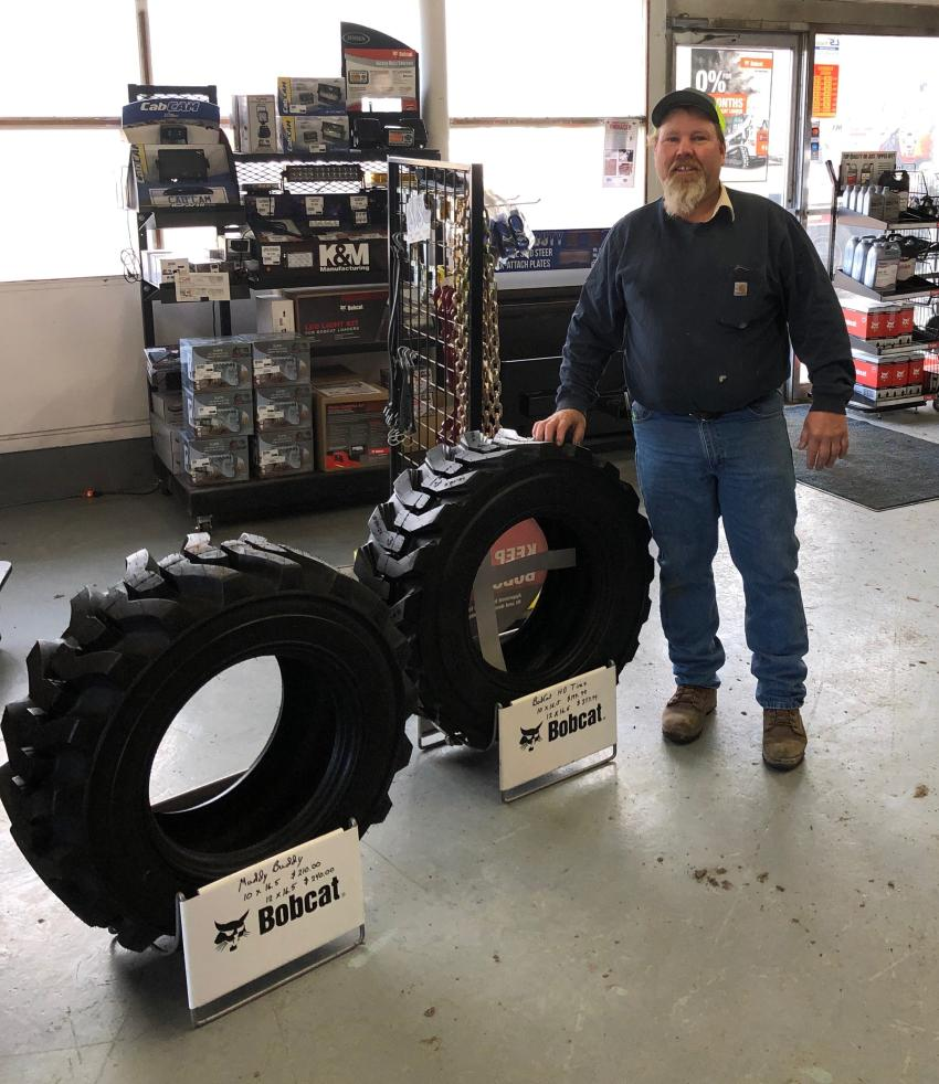 Tim Poortvliet of Poortvliet Dairy, Prinsburg, Minn., won a set of Bobcat heavy-duty tires in the open house drawing.