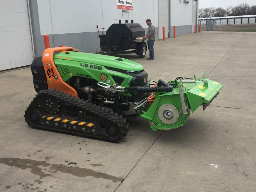 A Green Climber LV600 remote-controlled mower stands in the service area.