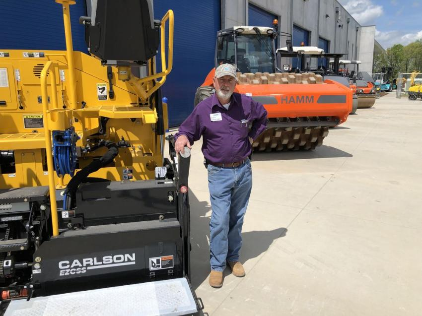 Gary Witherspoon of Sanders Utility Construction Co. looks over the Carlson pavers and Hamm compaction products.