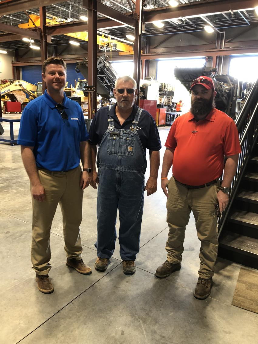 (L-R): Adam Cockerham, Linder Industrial Machinery, shows the shop area to Tam Wright and Tommy Rawe of C.K. Contractors & Development, Kings Mountain, N.C