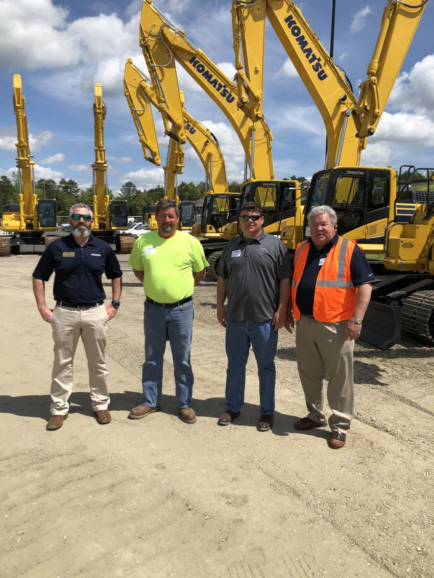 (L-R) are Bill Jacobs, Komatsu; Steve Sharpe and Scott Jones of Carolina's Contracting in Charlotte, N.C. and Bill Cross, area salesman of Linder.