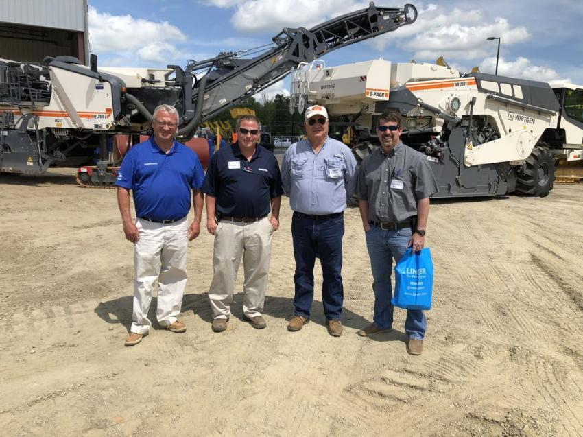 Discussing the Wirtgen products (L-R) are Earl Person and Scott McAteer of Linder; and Tommy Vaughn and Brandon Hill of Propst Construction in Concord, N.C.