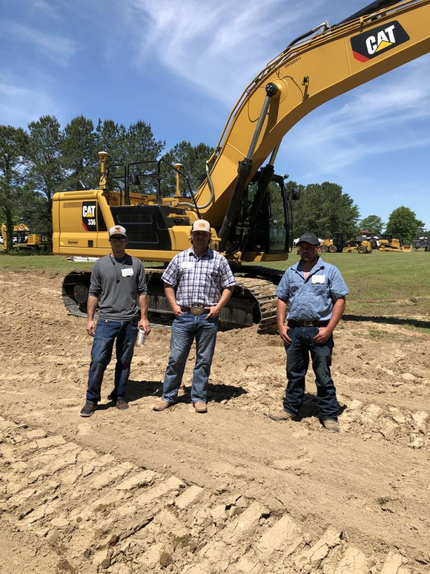 In front of the Cat 336 excavator (L-R) are Drew Clark, Robert Collins and Daniel Collins of Robert Collins Company in Columbia, S.C.  The Cat excavator offers premium performance with simple-to-use technologies like Cat Grade with 2D, Grade Assist, and Payload — all standard from the factory — to boost operator efficiencies up to 45 percent.