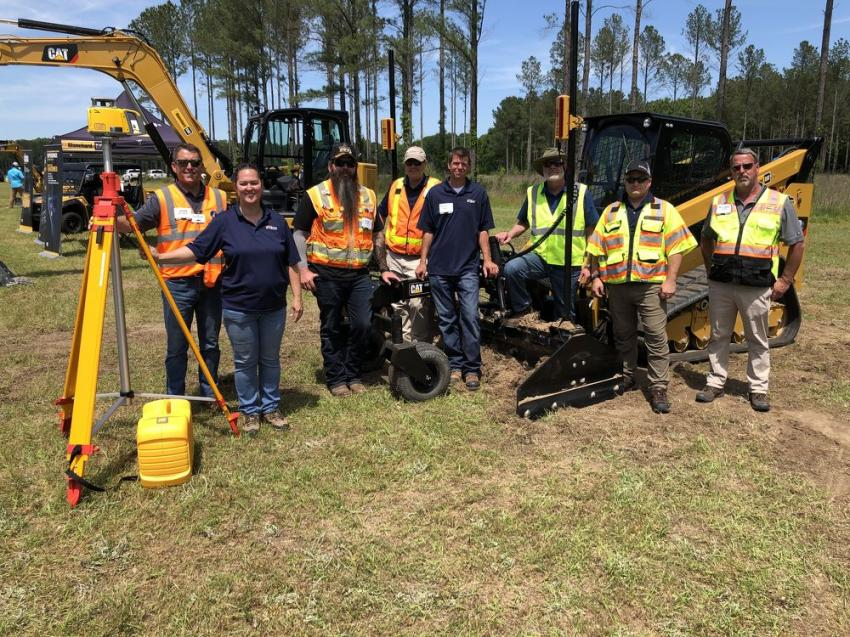 On hand to demonstrate the Cat 299 compact track loader (L-R) are John Balanda, Becky Huskins, Kyle Myers, Sean Frizelle, Benjamin Nann and Randy Rohrer of Sitech Mid-Atlantic; Mike Carris of Trimble and Michael Denning of Blanchard Machinery. The Cat 299, equipped with Cat Boxblade (BB124) and Trimble Earthworks Go!, offers many benefits.