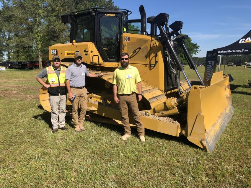 (L-R): Brian Smith of Blanchard Machinery and Heath Hanna and Robert Thompson of Contour Mining, Columbia, S.C., look over the Cat D6.