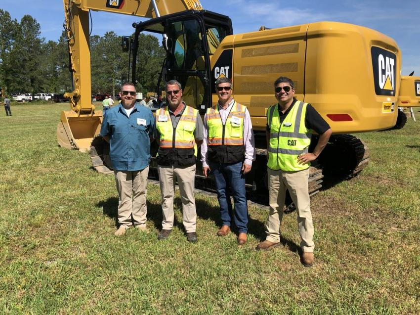 (L-R): Darrin Sheriff, Palmetto Corp. Florence, S.C.; Mike Denning and Scott Hill of Blanchard Machinery; Hugo Aravena of Caterpillar, gather in front of an excavator.