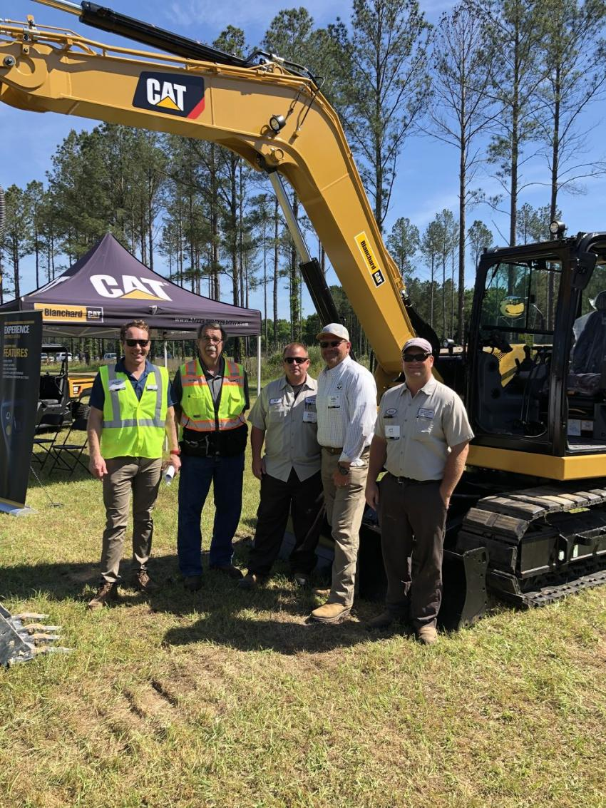 Looking over a Cat 308 excavator (L-R) are Jason Rupert of Caterpillar; Don Wise of Blanchard Machinery; B.J. Griffin of Lancaster County Water Sewer District; Carl Smith, CCS of York County; and Brad Faile, also of LCWSD.5