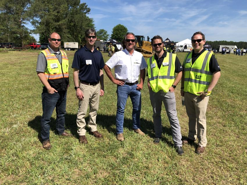 Touring the demo grounds (L-R) are Brian Hutchison, Blanchard Machinery; Brian Hoesel, Caterpillar; Roy Chipley, Chipley Company, Florence; and Brad Bahr and Zach Yaekel of Caterpillar.