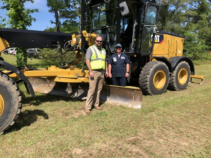 Andrew Wallace (L) of Blanchard Machinery goes over the Cat 120 motor grader with John Gunter of Owens Fisher in Lexington, S.C.
