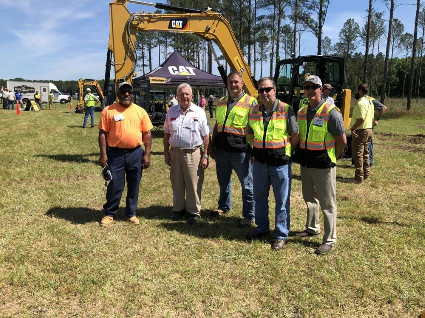 (L-R): Lawrence Quiller, LWQ Grading & More in Graniteville, S.C.; G.L. Williams, G.L. Williams & Daughter Trucking in Graniteville, S.C.; and Erik Hoffman, Dale Atkerson and Keith Lomas of Blanchard Machinery await the next live demo.