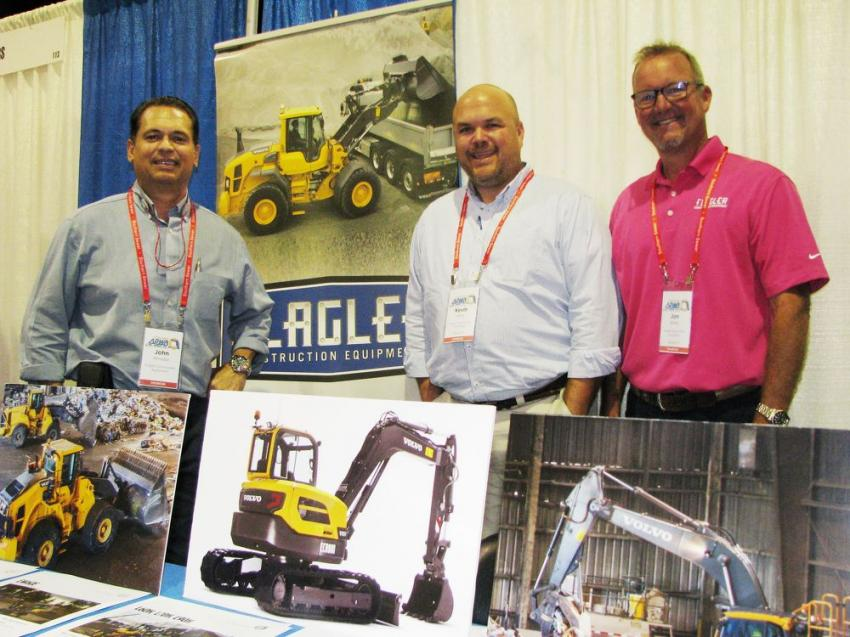 Talking about their product lineup at the show (L-R) are John Amador, Kevin Gray and Jon Bates of Flagler Construction Equipment.
