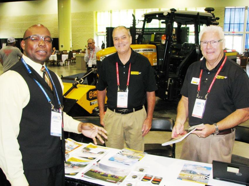 (L-R): William Anderson, public utilities coordinator for the city of Clearwater, Fla., talks with Greg Bennett and Garry Anderson of Kelly Tractor about their vegetation-control and heavy brush-mowing and clearing machines.
