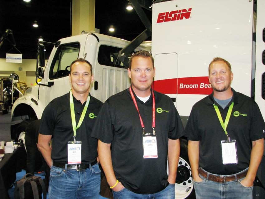 (L-R): Local Elgin dealers Will Anoka and John Miller, with Brian Stewart of Environmental Products Group, Apopka, Fla., had a nice-looking Elgin rig in their exhibit area.