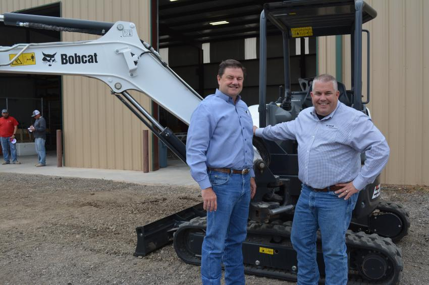 Whit Perryman (L), CEO of Compact Construction Equipment Inc. (CCE), and Jason Rush, CCE's Co-COO were on hand to officially open the company's Bobcat of Midland-Odessa branch. The company sells and services Bobcat equipment, like this E35 excavator, from its Midland-Odessa branch and eight other locations throughout Texas.